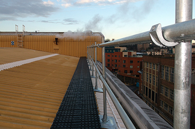 Edge protection for metal profile roofs